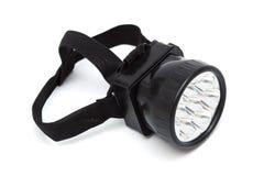 Taschenlampe auf seinem Kopf Lizenzfreie Stockbilder