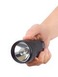 Taschenlampe in der Hand Lizenzfreies Stockfoto