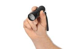 Taschenlampe in der Hand Stockfotografie