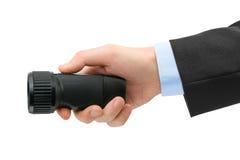 Taschenlampe in der Hand Lizenzfreie Stockfotos