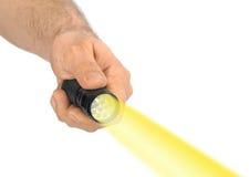 Taschenlampe in der Hand Stockbild