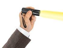 Taschenlampe in der Hand Lizenzfreie Stockfotografie