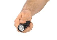 Taschenlampe in der Hand Stockbilder