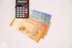 Taschenrechner auf Malaysia-Anmerkungen Lizenzfreie Stockfotos