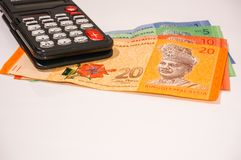 Taschenrechner auf Malaysia-Anmerkungen Lizenzfreies Stockbild
