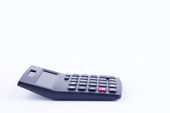 Taschenrechner für die Berechnung der Buchhaltungs-Geschäftsberechnung der Zahlen erklärenden auf dem weißen Hintergrund lokalisi Lizenzfreie Stockfotografie