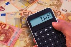 Taschenrechner mit der Wort Steuer Stockfotografie