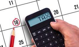 Taschenrechner mit der Wort Steuer Lizenzfreie Stockfotografie