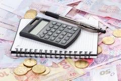 Taschenrechner und Notizbuch Lizenzfreies Stockfoto