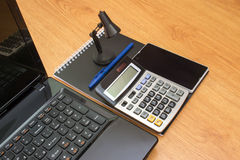 Taschenrechnernotizbuchlaptop und -telefon Lizenzfreies Stockfoto