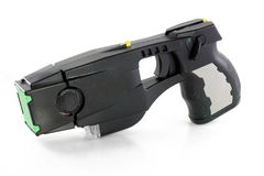 Taser gun. A modern day taser isolated on a white background royalty free stock photography