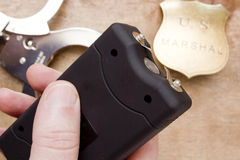 Free Taser In Hand Men Stock Photo - 60231900