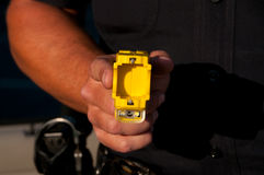 Taser weapon. A police officer holding a Taser stun gun in his hand ready to use Stock Images