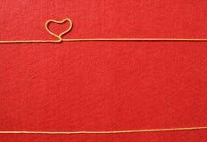 Tasiemkowy powitanie i serca na czerwonym tle Zdjęcie Stock
