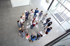 Tasks done at the end of the year. Manager throws done tasks at the end of the year with workers in circle stock images