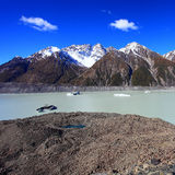 New Zealand attraction, Tasman Glacier under blue  Royalty Free Stock Photos