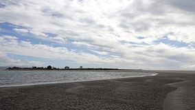 Ohiwa from Ohope beach in Whakatane, New Zealand. Tasman sea at Ohiwa beach in the Bay of Plenty on the North Island of New Zealand is voted as New Zealand royalty free stock photos
