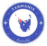 Tasmania circular patriotic badge. Grunge rubber stamp with island flag, map and name written along circle border, vector illustration stock illustration