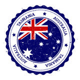 Tasmania flag badge. Vintage travel stamp with circular text, stars and island flag inside it. Vector illustration stock illustration