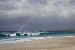 Tasmanian beach and rainbow Stock Photos
