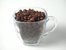 Tasse avec des grains de café Photo stock