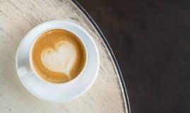 Tasse avec du café sur la table Photographie stock libre de droits