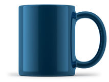 Tasse bleue d'isolement photo stock