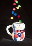 Tasse de Bokeh de bonhomme de neige Photo stock