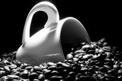 Tasse de café avec des haricots de caffee Image libre de droits