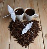 Tasse de café avec la grue Photos stock