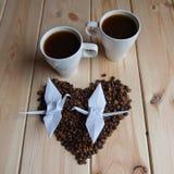 Tasse de café avec la grue Images libres de droits