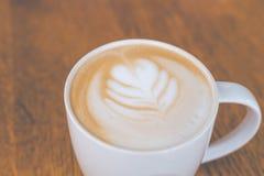 Tasse de café chaud d'art de latte Photo stock