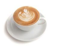 Tasse de café d'art de latte de rosetta sur le fond blanc d'isolement Image libre de droits