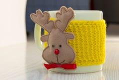 Tasse de café et de cerfs communs Image stock