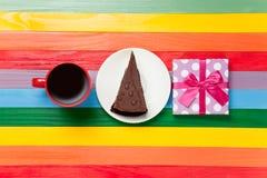 Tasse de café et de gâteau d'un plat Images stock
