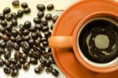 Tasse de café et grains de café Image stock