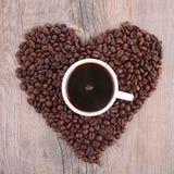 Tasse de café et haricot de coffe Photos libres de droits