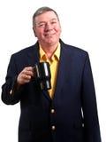 Tasse de café mûre de prise d'homme d'affaires, d'isolement Image libre de droits