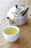 Tasse de café sur mat rustique Photo stock