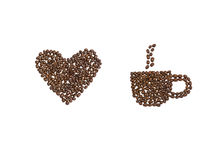 Tasse de coeur et de café d'amour en grains de café Images stock