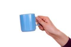 tasse de main Image libre de droits