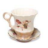 Tasse de thé antique sur la soucoupe Images libres de droits