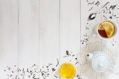 Tasse de thé de citron, de miel et d'une cuillère Photographie stock