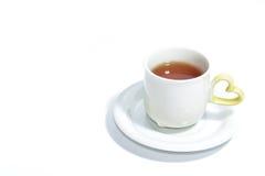 Tasse de thé d'amour d'isolement sur le blanc Photo libre de droits