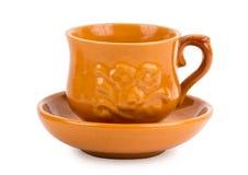 Tasse de thé d'argile avec la soucoupe Photo stock