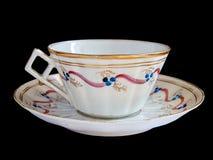 tasse de thé de fantaisie de soucoupe Photo libre de droits