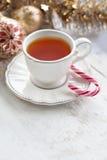 Tasse de thé de Noël blanc Photographie stock libre de droits