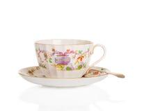 Tasse de thé et soucoupe antiques Image stock