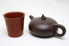 Tasse de thé et théière Photos stock