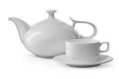 Tasse de thé et théière blanches Photos libres de droits